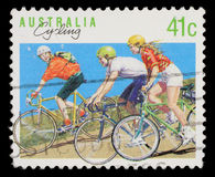 Stamp printed in Australia shows the Cycling Stock Photos