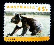 A stamp printed in Australia shows an image of Koala on value at 45 cent. BANGKOK, THAILAND. – On May 27, 2018 - A stamp printed in Australia shows an image Stock Images