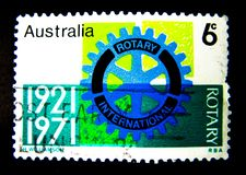 A stamp printed in Australia shows an image of Rotary international 1921-1971 on value at 6 cent. royalty free stock photo