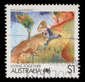 Stamp printed in Australia shows Living Together cartoons Rescue and Emergency. Circa 1988 stock images