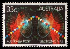 Stamp printed in Australia shows symbols of electronic mail Royalty Free Stock Photo