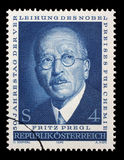 Stamp printed in the Austria shows Fritz Pregl. A stamp printed in the Austria shows Fritz Pregl, Chemist, 50th Anniversary of the Awarding of the Nobel Prize royalty free stock photo