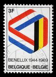 Stamp printed in the Belgium shows Mobius Strip in Benelux Colors. A stamp printed in the Belgium shows Mobius Strip in Benelux Colors, 25th Anniversary of the royalty free stock photos