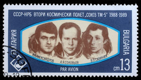 Stamp printed in Bulgaria shows Cosmonauts Anatoly Solovyev, Viktor Savinykh, Aleksandr Panayatov Aleksandrov of space ship Soyuz Royalty Free Stock Photos