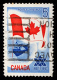 Stamp printed in Canada shows Canada flag. Circa 1967 Stock Photography