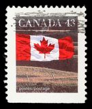 Stamp printed in Canada shows Canadian flag and Prairie Stock Photography