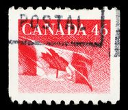Stamp printed by Canada, shows Canadian flag Stock Image