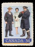 Stamp printed by Canada, shows 1910 Gunner`s Mate, World War II Officer Stock Photography