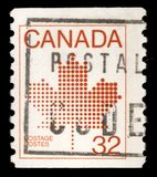 Stamp printed in Canada shows maple leaf, a symbol of Canada. A stamp printed in Canada shows maple leaf, a symbol of Canada, series, circa 1982 royalty free stock images