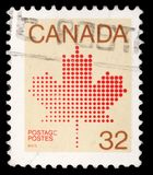 Stamp printed in Canada shows maple leaf, a symbol of Canada. A stamp printed in Canada shows maple leaf, a symbol of Canada, series, circa 1982 royalty free stock photos