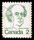 Stamp printed in Canada shows a portrait of Canadian Prime Minister Sir Wilfrid Laurier. Circa 1972 Stock Image