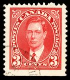 Stamp printed in Canada, shows portrait of King George VI Stock Photo