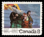 Stamp printed by Canada, shows Scottish Settlers. Circa 1973 Stock Photo