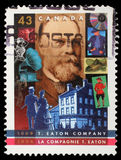 Stamp printed by Canada, shows T. Eaton Company, 125th Anniv Stock Photography