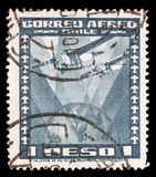Stamp printed in Chile shows Fokker Super Universal Aircraft over Globe. A stamp printed in Chile shows Fokker Super Universal Aircraft over Globe, circa 1934 Stock Images
