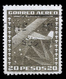 Stamp printed in Chile shows stylized Dornier Wal flying boat and compass Stock Photo