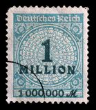 Stamp printed in the Federal Republic of Germany shows image of hyper inflated numbers. A stamp printed in the Federal Republic of Germany shows image of hyper Stock Image