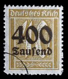 Stamp printed in the Federal Republic of Germany shows image of hyper inflated numbers. A stamp printed in the Federal Republic of Germany shows image of hyper Royalty Free Stock Images