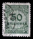 Stamp printed in the Federal Republic of Germany shows image of hyper inflated numbers. A stamp printed in the Federal Republic of Germany shows image of hyper Stock Images