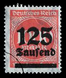 Stamp printed in the Federal Republic of Germany shows image of hyper inflated numbers. A stamp printed in the Federal Republic of Germany shows image of hyper Royalty Free Stock Photo