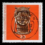 Stamp printed in GDR shows bronze head from Africa, The Ethnography Museum of Leipzig. A stamp printed in GDR shows bronze head from Africa, The Ethnography Stock Photography