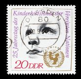 Stamp printed by GDR shows Childs Head and UNICEF Emblem Royalty Free Stock Photo