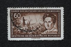 Stamp printed in GDR shows Rosa Luxemburg. A stamp printed in GDR shows Rosa Luxemburg, Marxist theorist, philosopher, economist and revolutionary socialist Royalty Free Stock Photo