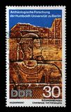 Stamp printed in GDR shows Sudanese Archaeological Excavations by Humboldt University Expedition. A stamp printed in GDR shows Sudanese Archaeological stock photography