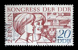 Stamp printed in GDR, shows two young women, devoted to the Second Congress of Women Stock Photos