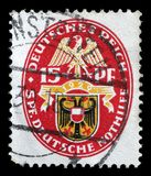 Stamp printed in the German Reich shows Coat of arms. A stamp printed in the German Reich shows Coat of arms, Charity Stamps, circa 1928 Royalty Free Stock Image