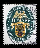 Stamp printed in the German Reich shows Coat of arms. A stamp printed in the German Reich shows Coat of arms, Charity Stamps, circa 1928 Royalty Free Stock Photos