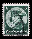 Stamp printed in the German Reich shows image of Friedrich der Grosse. A stamp printed in the German Reich shows image of Friedrich der Grosse, third Royalty Free Stock Photo