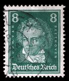 Stamp printed in the German Reich shows Ludwig van Beethoven. A stamp printed in the German Reich shows Ludwig van Beethoven, German composer and pianist, circa Royalty Free Stock Images