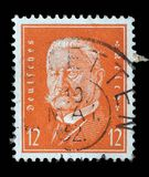 Stamp printed in the German Reich shows Paul von Hindenburg. A stamp printed in the German Reich shows Paul von Hindenburg 1847-1934, 2nd President of the German Royalty Free Stock Image