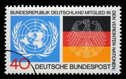 Stamp printed in the Germany shows Emblems from UN and German Flags, Germany`s admission to the UN Stock Image