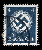 Stamp printed in Germany shows the Swastika in an oak wreath Stock Image