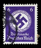 Stamp printed in Germany shows the Swastika in an oak wreath Stock Photo