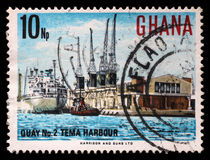 Stamp printed in Ghana shows Tema Harbour. A stamp printed in Ghana shows Tema Harbour, National Symbols, circa 1967 stock image