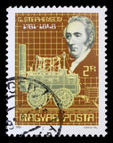 Stamp printed by Hungary, shows George Stephenson and his steam locomotive Royalty Free Stock Photos