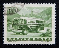 A stamp printed in Hungary shows postage bus, circa 1963 Royalty Free Stock Photography
