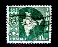 A stamp printed in India shows an image of a shape of India country. royalty free stock images