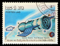 Stamp printed in Laos shows experimental flight of Soyuz and Apollo Stock Image