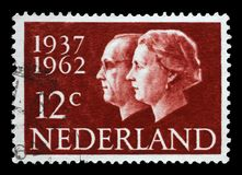 Stamp printed in Netherlands shows portraits of Queen Juliana and Prince Bernhard. A stamp printed in Netherlands shows portraits of Queen Juliana 1909-2004 and Stock Images
