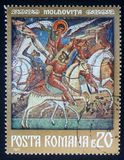 Stamp printed in the Romania, shows a fresco of St. George, Moldovita Monastery Stock Images