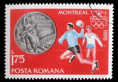 Stamp printed in Romania, shows Handball, and Olympic Rings. A stamp printed in Romania, shows Handball, and Olympic Rings, with inscription Montreal, 1976 Royalty Free Stock Photography