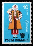 Stamp printed in Romania shows image of a Suceava woman. A stamp printed in Romania shows image of a Suceava woman, from the regional costumes series, circa 1973 Royalty Free Stock Photos
