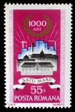Stamp printed in Romania shows Old and new buildings in Satu-Mare. A stamp printed in Romania shows Old and new buildings in Satu-Mare, Satu-Mare milenium issue Royalty Free Stock Images