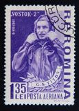 Stamp printed in Romania shows portrait of soviet cosmonaut Georgy Titov, circa 1961 Royalty Free Stock Image