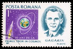 Stamp printed in Romania shows portrait of Yuri Gagarin. A stamp printed in Romania shows portrait of Yuri Gagarin with inscription and name of series ` stock photography