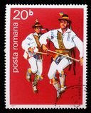 Stamp printed by Romania, shows Romanian male folk dancer. A stamp printed by Romania, shows Romanian male folk dancer, circa 1977 stock image